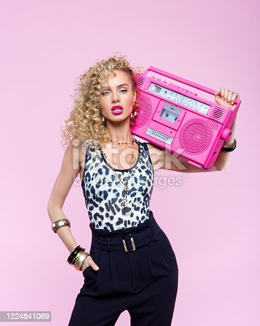 807419930 istock photo Confident woman in 80's style outfit holding boom box 1224841069