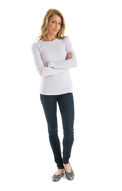 Confident Woman In Casuals Standing Arms Crossed Portrait of confident young woman in casuals standing arms crossed against white background long sleeved stock pictures, royalty-free photos & images