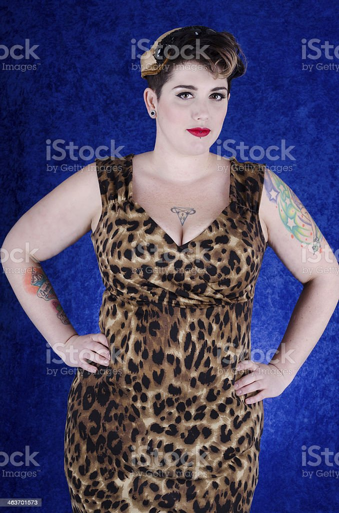 Confident woman in vintage hat and leopard print dress. royalty-free stock photo