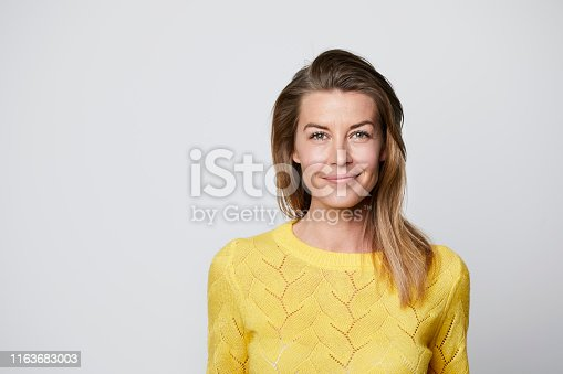 Confident woman in yellow top, portrait