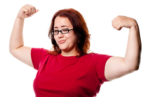 confident woman shows off arms - funny fat lady stock photos and pictures
