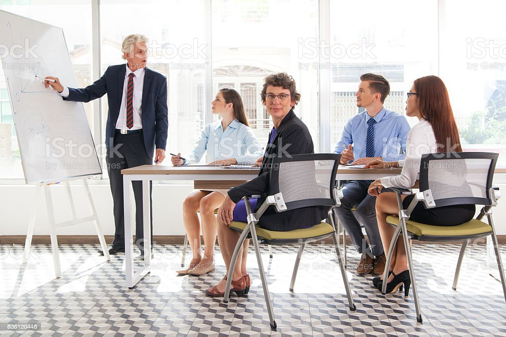 Confident woman sitting at business training stock photo
