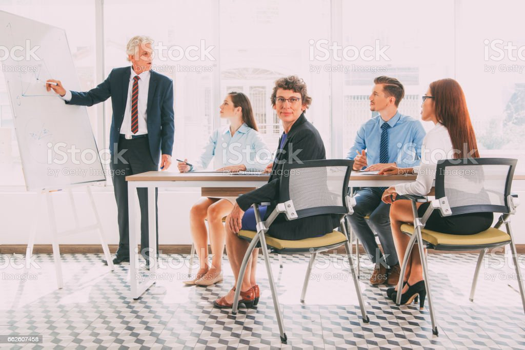 Confident woman sitting at business training_tone stock photo