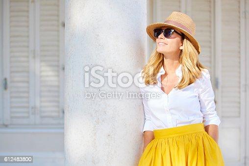 istock Confident woman smiling 612483800