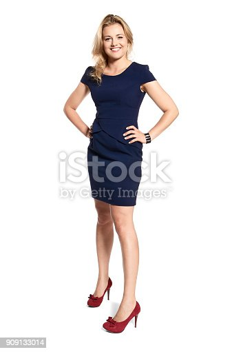 istock Confident Woman Smiling to the Camera 909133014