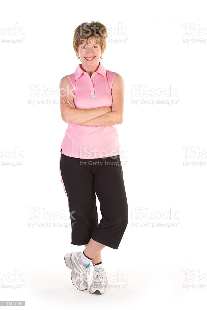 Confident woman, standing with arms folded, on a white background royalty-free stock photo