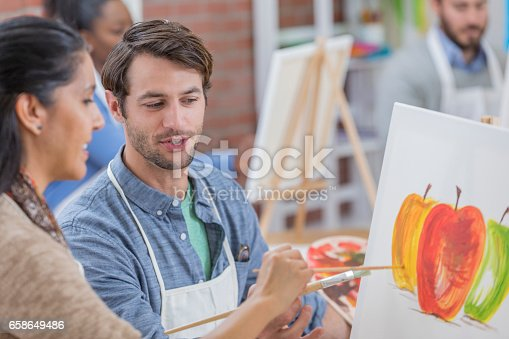 658645980 istock photo Confident woman takes art lessons 658649486
