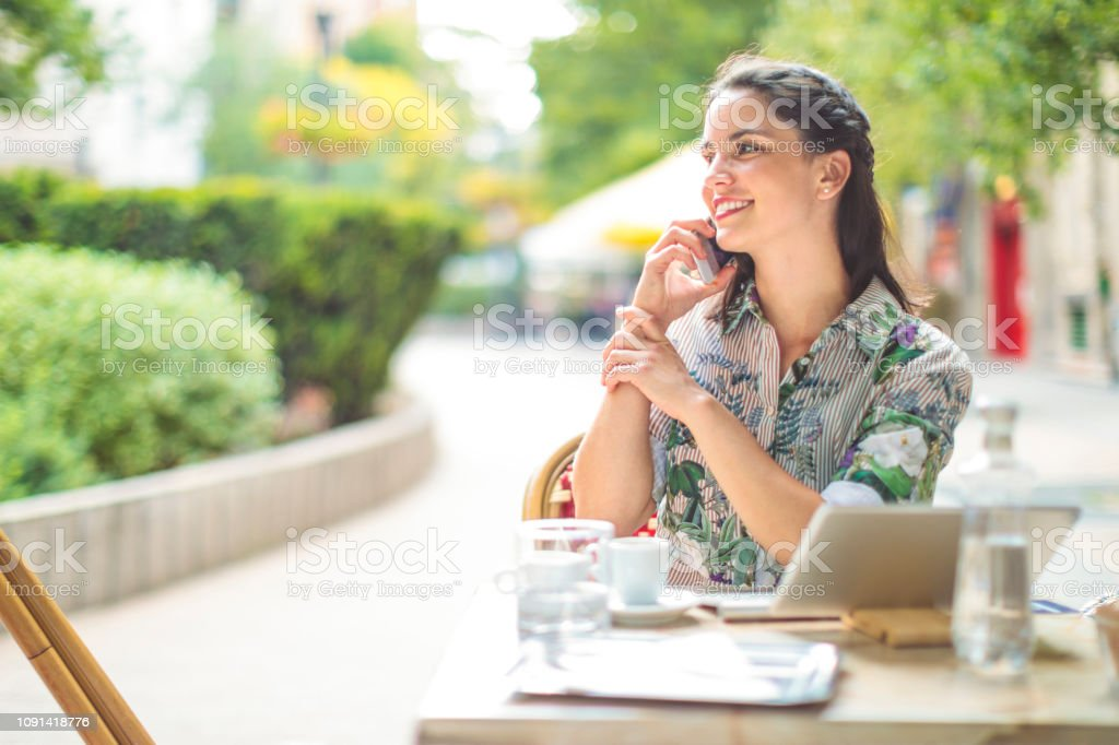 Confident woman taking a break in a coffee shop