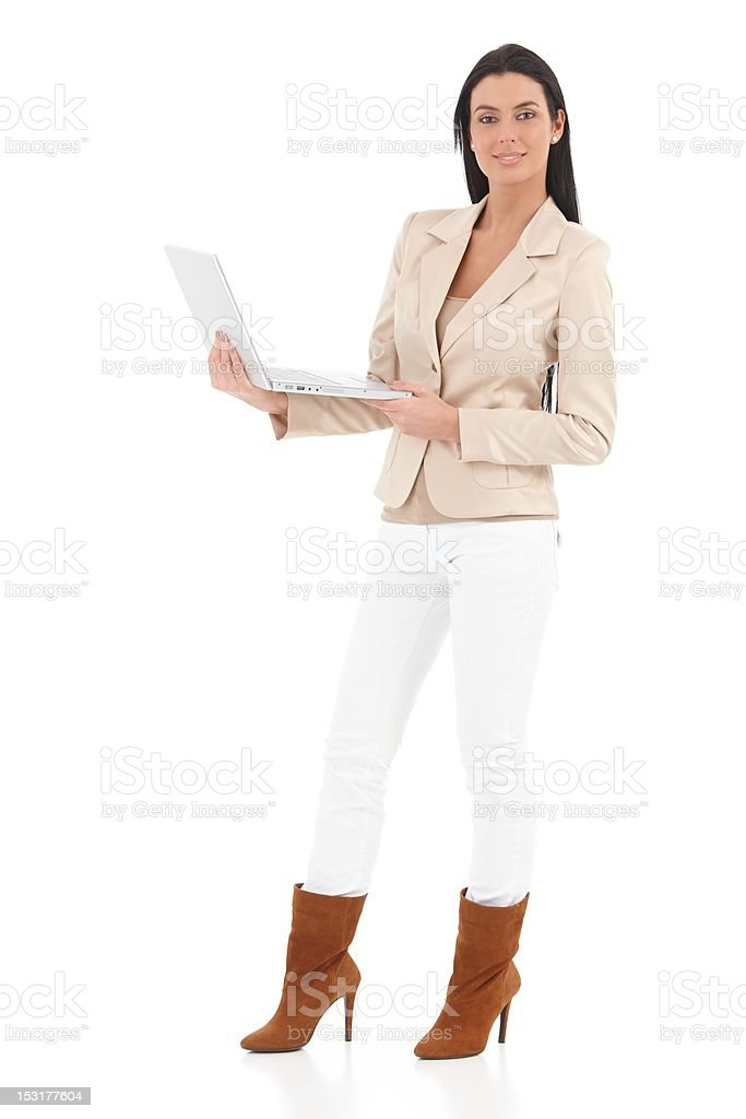 Confident woman using laptop smiling royalty-free stock photo