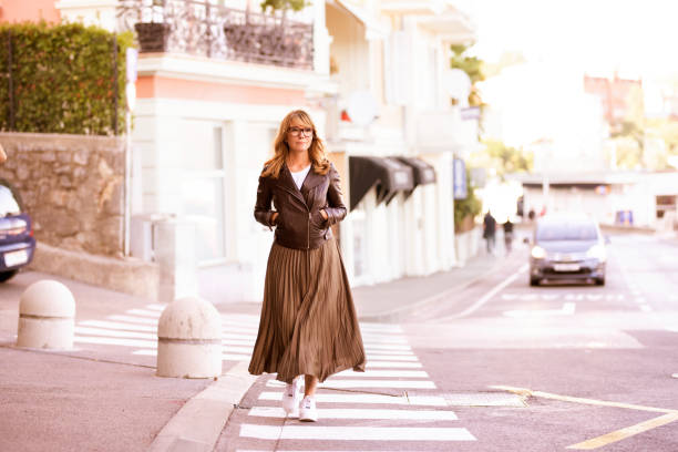 Cтоковое фото Confident woman wearing casual clothes while walking on the street