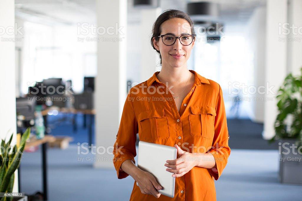 Confident woman with eyeglasses stock photo