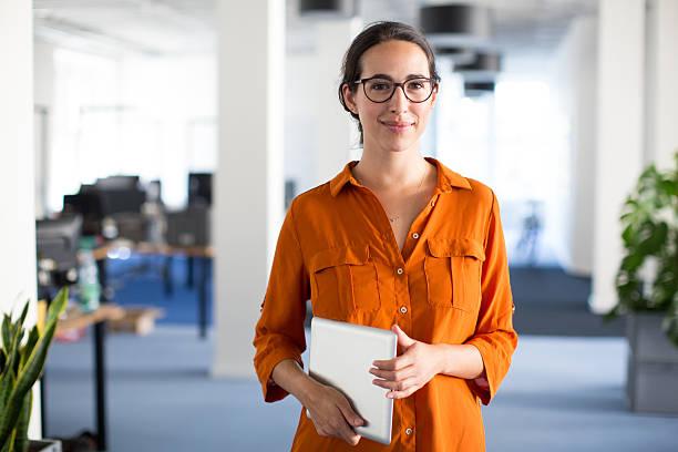 confident woman with eyeglasses - deutsche frauen stock-fotos und bilder