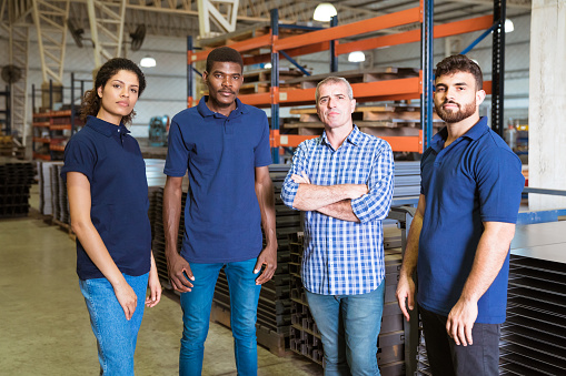 Confident Workers Standing In Factory Stock Photo - Download Image Now