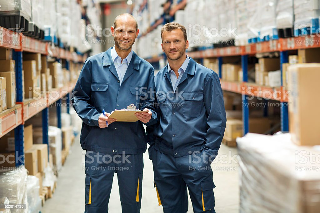 Confident workers standing in warehouse stock photo