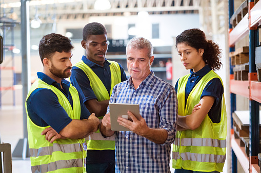 Confident Workers Using Digital Tablet In Industry Stock Photo - Download Image Now