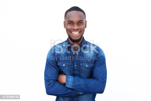 Portrait of a confident young african guy smiling with arms crossed against white background