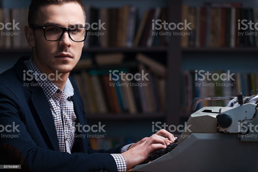 Confident young author. stock photo