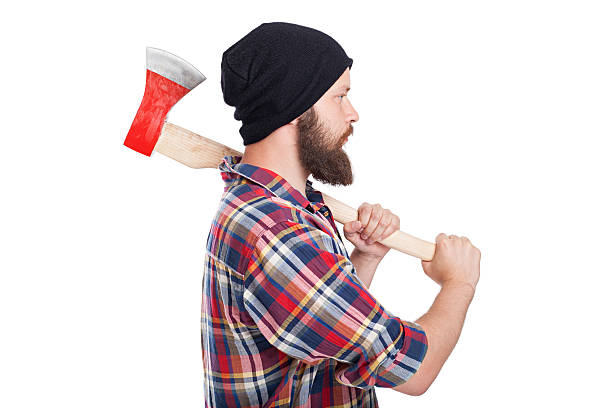 Confident young bearded man holding an axe stock photo