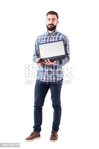 Confident young bearded programmer showing blank empty laptop monitor. Full body isolated on white background.