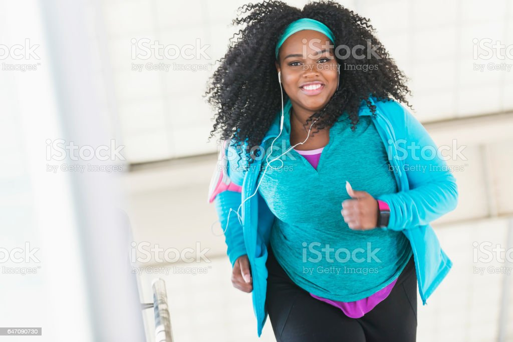 Confident young black woman exercising stock photo