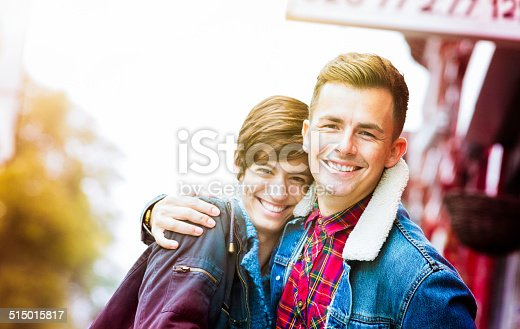 Confident young British couple Autumn portrait outdoors. Narrow DOF, with focus on the man.