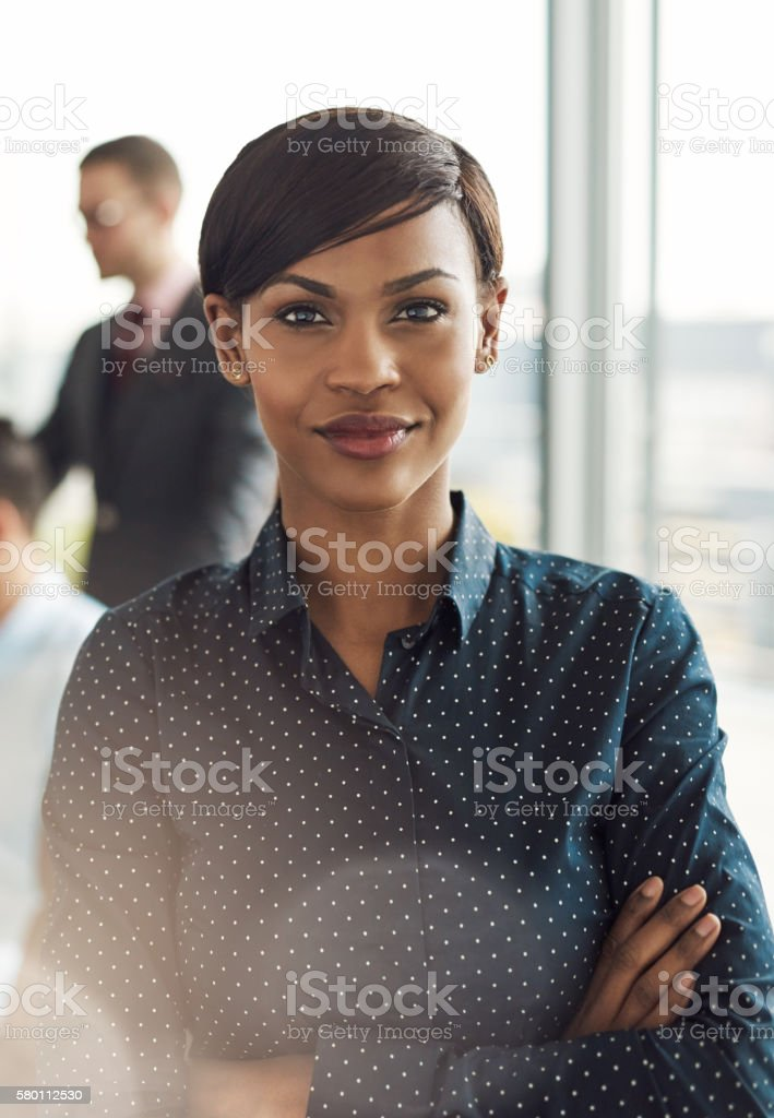 Confident young business woman in office stock photo