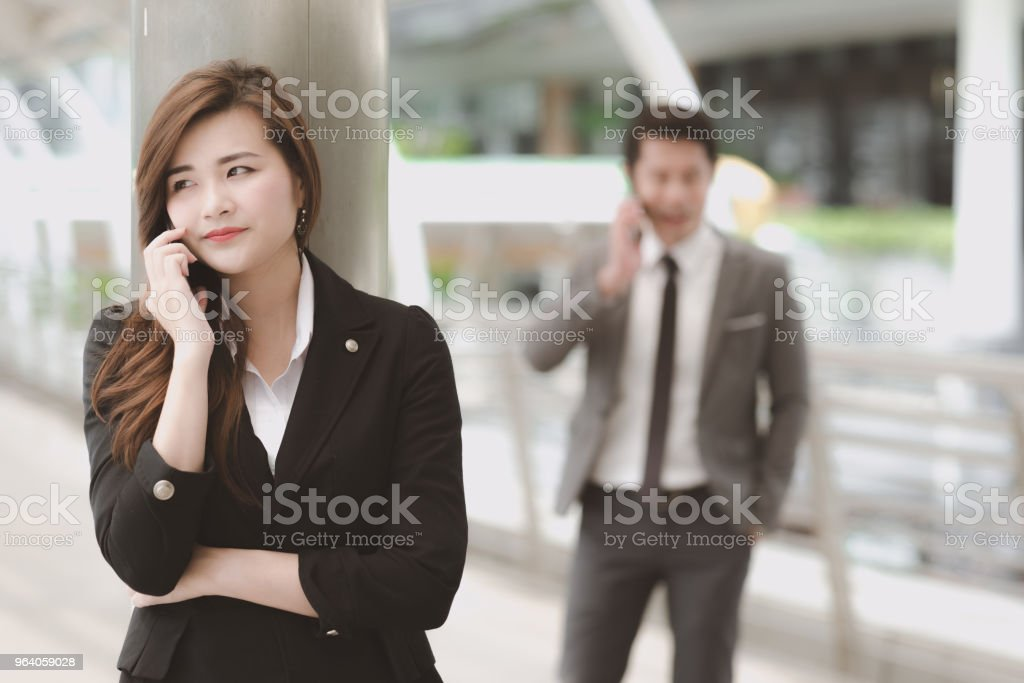 Confident young business woman in smart office dress on phone. - Royalty-free Adult Stock Photo