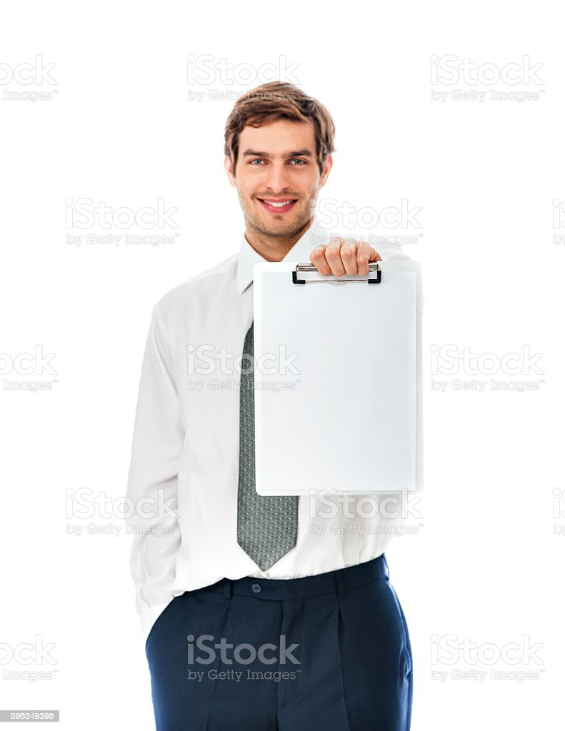 Confident young businessman holding a blank placard royalty-free stock photo