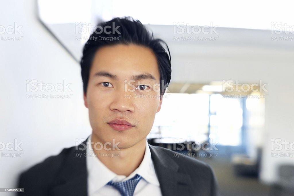 Confident young businessman looking at you royalty-free stock photo