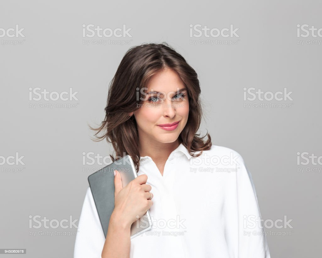 Confident young businesswoman holding a digital tablet - Royalty-free 25-29 Years Stock Photo