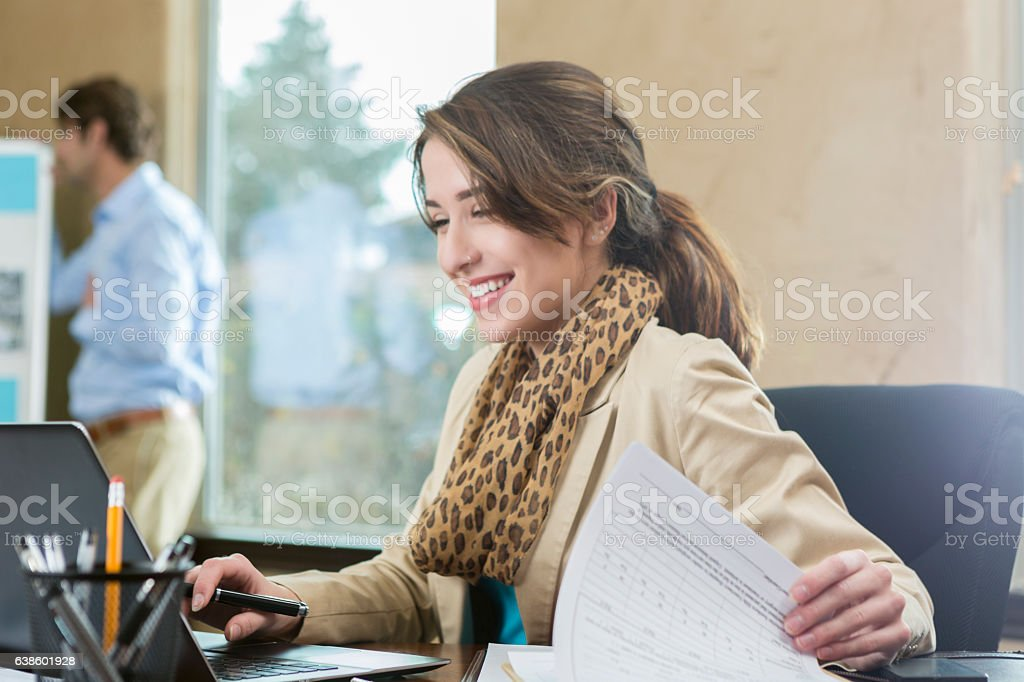 Confident young businesswoman in the office stock photo