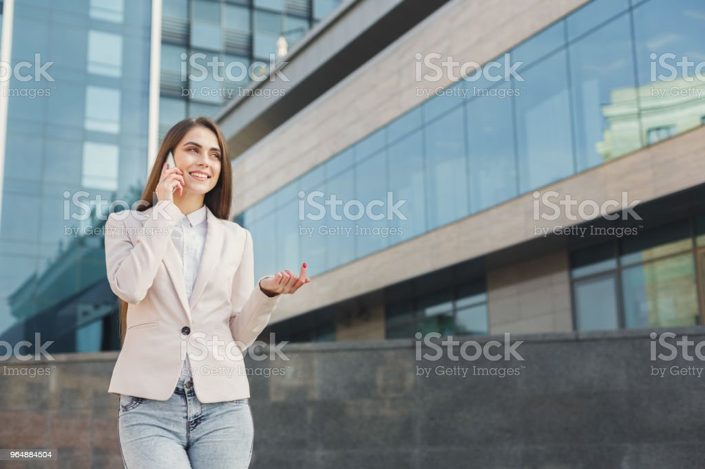 Confident young businesswoman talking on mobile royalty-free stock photo