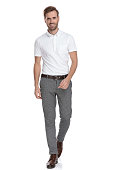istock confident young casual man is walking forward 1131988553