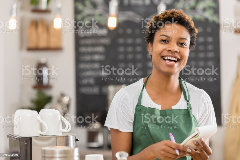 Confident young coffee shop owner stock photo