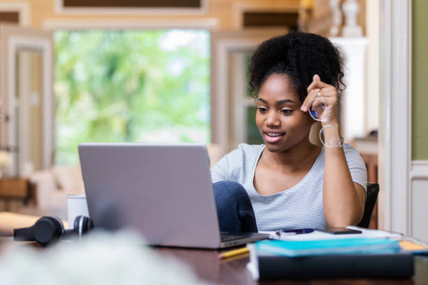 Confident young college student studies for test stock photo