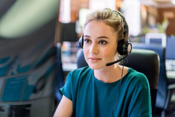 Confident young customer service representative stock photo
