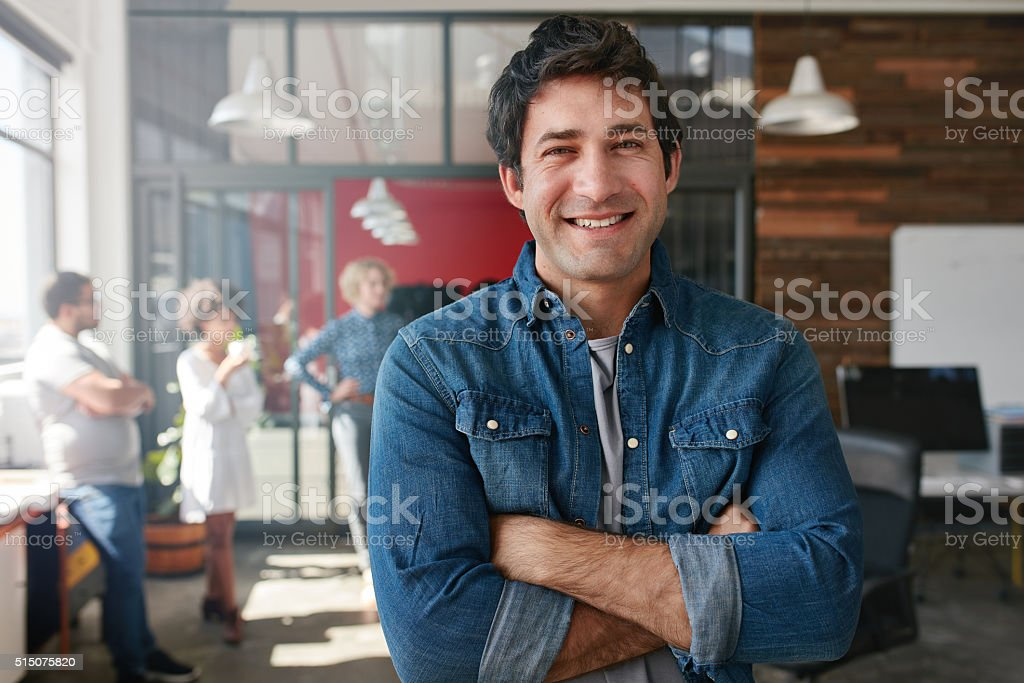 Confident young designer in creative office. stock photo