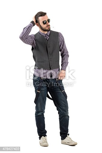 istock Confident young fashionable man smoking cigarette looking away 475427422