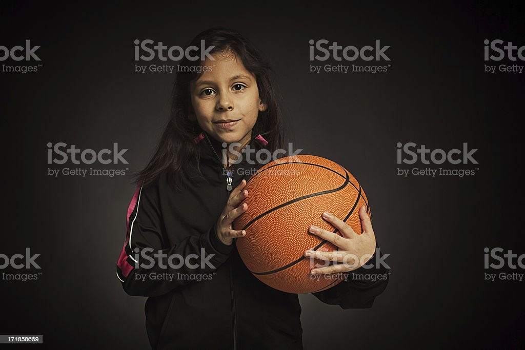 Confident young female basketball player stock photo