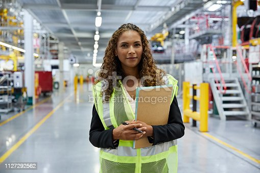 istock Confident young female supervisor with document 1127292562