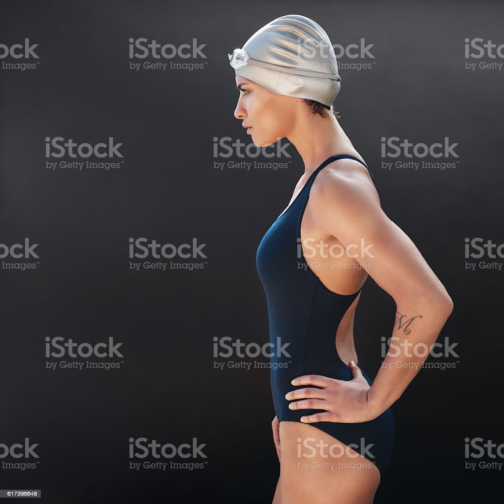 Confident young female swimmer stock photo