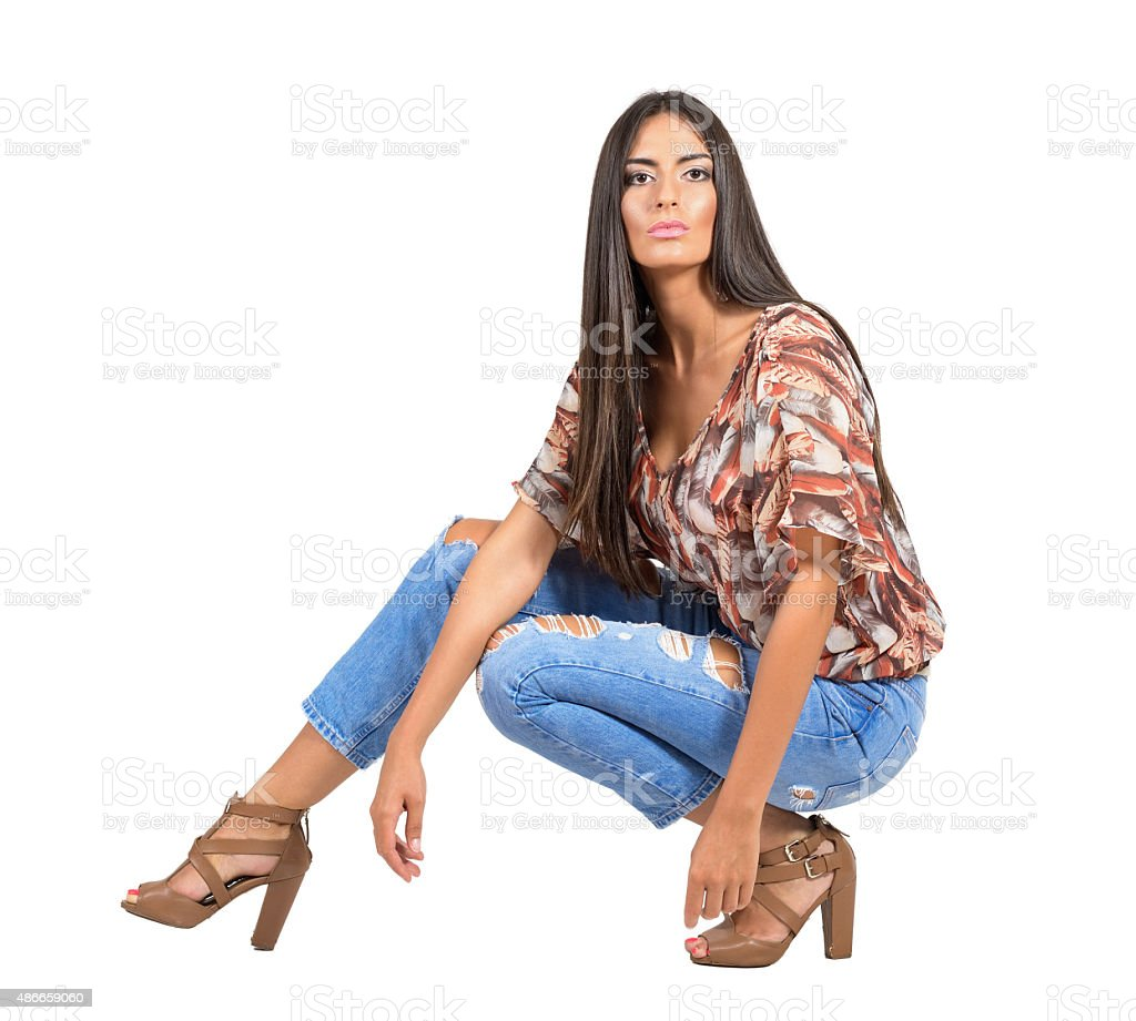 Confident Young Latin Woman In Casual Clothes Crouched ...