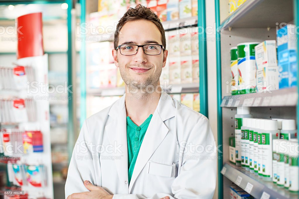 Confident young male druggist stock photo