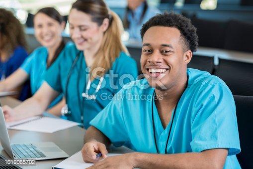 istock Confident young man enjoys medical training class 1019065702