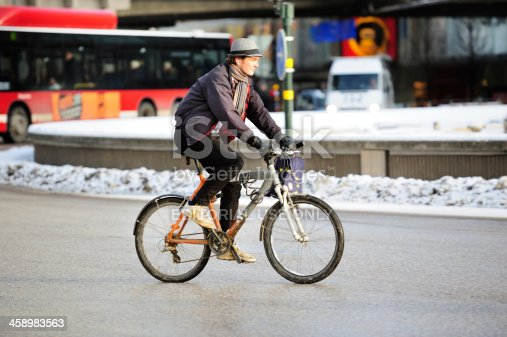 863454090 istock photo Confident young man on bicycle in profile 458983563