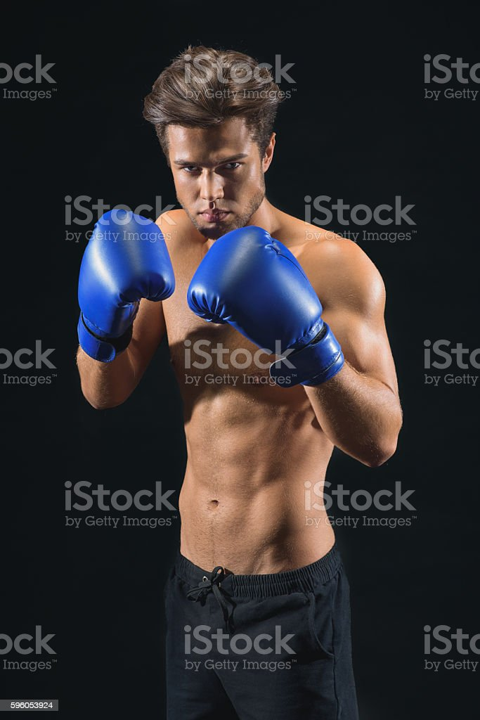 Confident young man preparing for box royalty-free stock photo