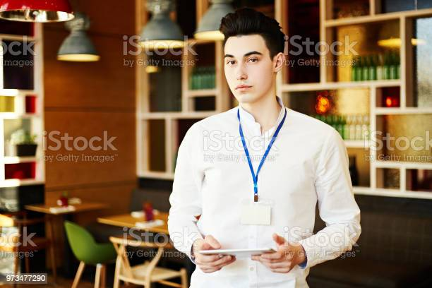 Confident young man wearing white shirt and id card standing with in picture id973477290?b=1&k=6&m=973477290&s=612x612&h=iikyqjckrnw1ulgapycdi1 0keho2h0bjhmaxtoomzu=