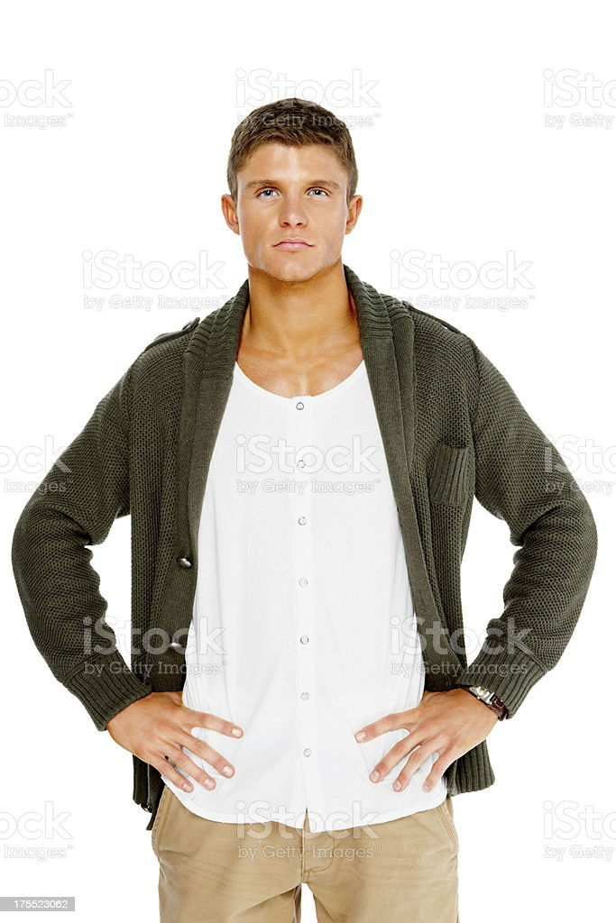 Confident young man with his hands on hips royalty-free stock photo