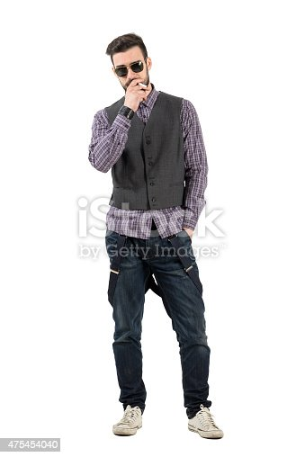 istock Confident young man with sunglasses smoking cigarette 475454040