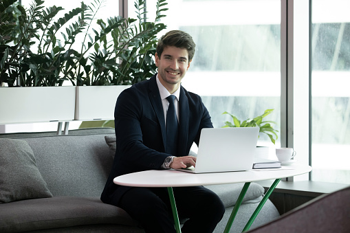 825082848 istock photo Confident young smiling successful businessman looking at camera. 1206893390